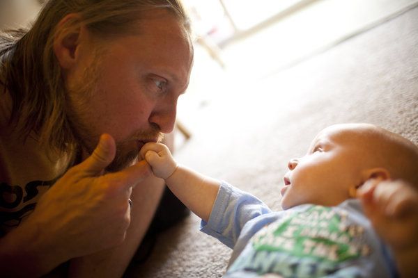 Jonathan Heisey-Grove kisses his 4-month-old son, Zane, in their home in Alexandria, Va. Jonathan is part of a growing number of fathers who stay at home full time while their wives financially support the family.