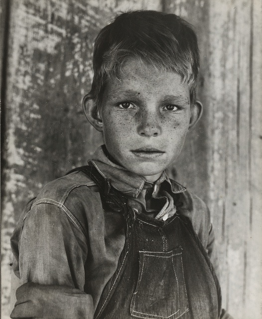 Dorothea Lange photo of a young man growing up in depression poverty.