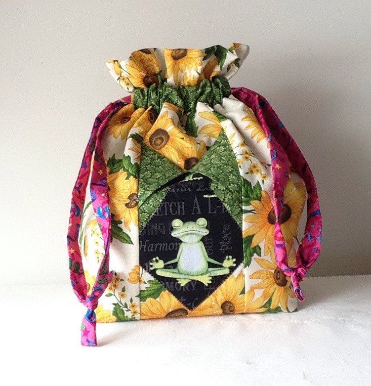 A personal favorite from my Etsy shop https://www.etsy.com/listing/223017576/namaste-frog-hanging-pocket-project-bag