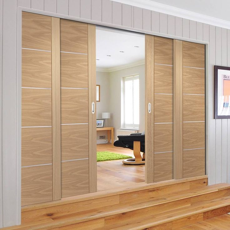 Quad Telescopic Pocket Portici Oak Veneer Door - Aluminium Inlay - Prefinished. #flushdoors #internaldoors #oakdoors #hiddendoors #telescopicdoors #quaddoors #eclisse #xljoinery #directdoors