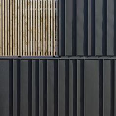 Alternate width standing seam metal vertical siding