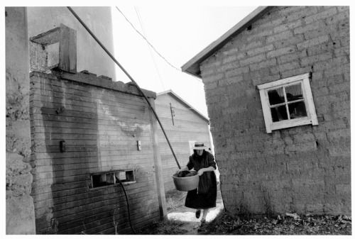 Larry Towell - 1991. Chihuahua. Cuauhtemoc Colonies. Mennonites. Maria Thiessen with laundry