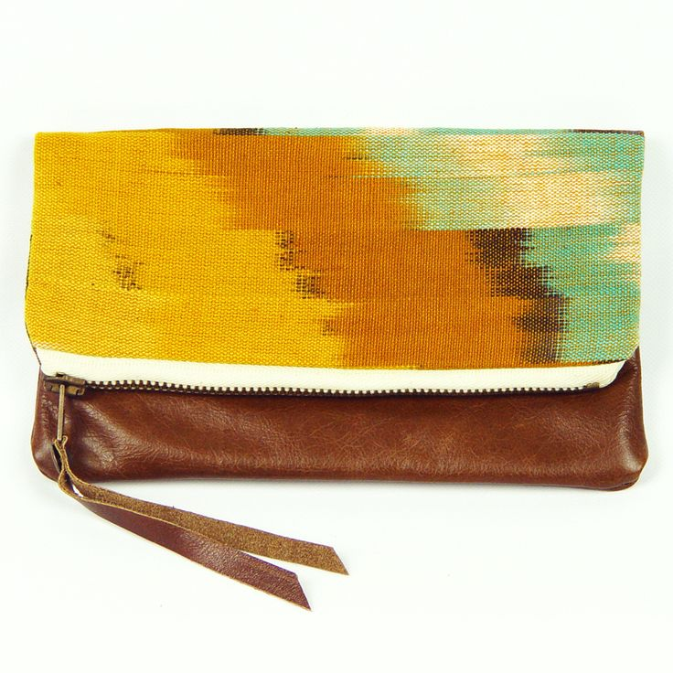 Clutch bag, handmade from vintage ikat fabric and cowhide. (http://www.ifoundlove.com.au/vintage-ikat-clutch/)