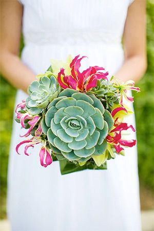 Unique wedding bouquet with succulents and gloriosa lilies