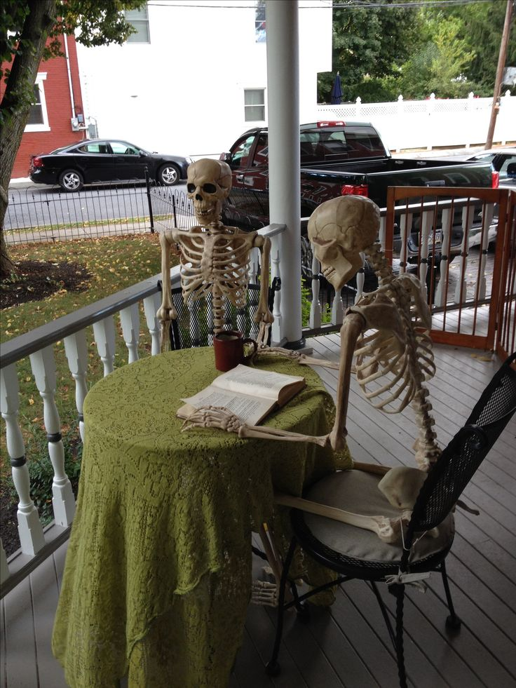"""Our yearly Halloween guests enjoy the porch of our """"Dead and Breakfast"""""""