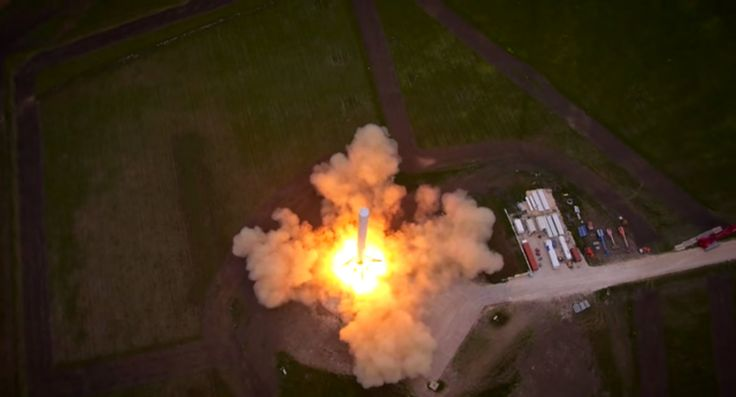 A SpaceX Falcon 9 Reusable rocket prototype fires up its nine Merlin rocket engines for a debut launch and landing test in McGregor, Texas in this aerial view from a drone video released by SpaceX on April 18, 2014. Original Image Credit: SpaceX