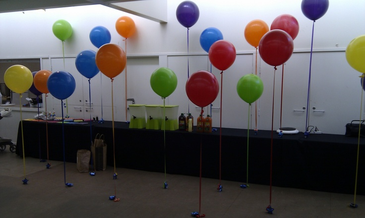 """Colourful 17"""" round balloons set at different heights for colourful effect at 1st birthday party"""