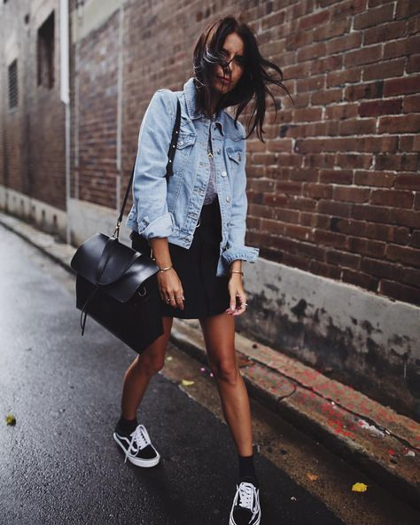 showin' some leg - skirt + sneakers + denim jacket + black bag.