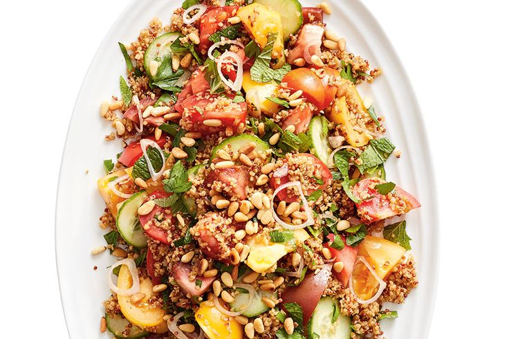 Load up on fresh herbs, cucumbers and a variety of colourful tomatoes at your local farmers' market for this dish.
