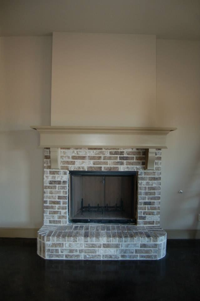 Living room 41 brick fireplace with painted manetle and for Fireplace half stone