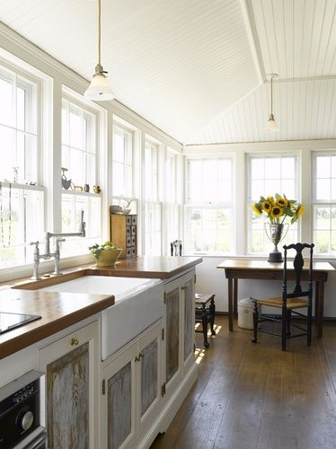 Cottage Chic - white cabinets and butcher block counters - love all the windows