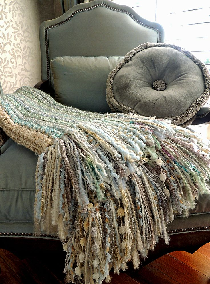 """I've crocheted 7 of these for Christmas gifts this year and am having a hard time giving them away because they match my décor! haha. Soft pretty throw or """"Lapghan"""" I made from a very simple single crochet pattern I found here on Pinterest (see link). However, I made an 8"""" fringe of various textures and yarns to make it a little more interesting. I used left over Lion Brand Homespun yarn in 2 shades - Ocean and Pearls for the body."""