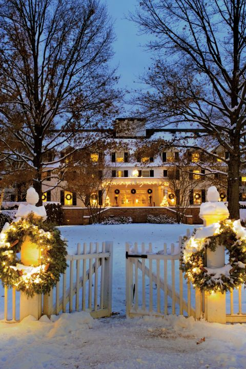 The historic Woodstock Inn dresses up for the holiday season. Centrally located on Woodstock, VT's village green, the inn provides a warm welcome to travelers enjoying the town's snowy Wassail Weekend celebration.