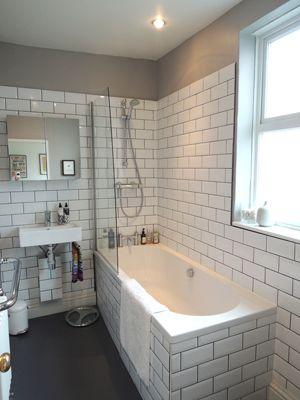 @Nicole Renner Beehler  Brick tiles, dark grout bathroom, grey vinyl flooring, glass shower shield