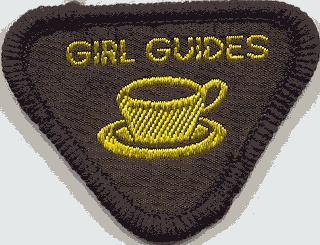 Hostess, the most popular Brownie badge because we got to bake cakes and serve tea