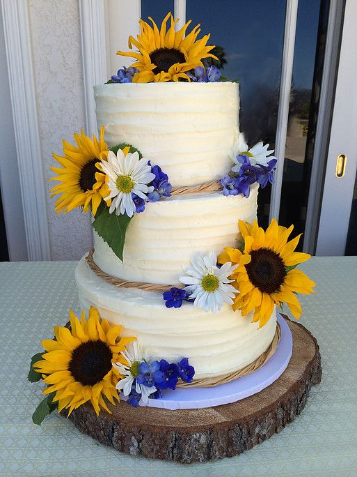 This cake had a simple textured buttercream design enhanced with raffia trim and fresh sunflowers, daisies, and delphiniums. Sweet Art Bake Shop Sweet Art Bake Shop is a licenced home bakery located in central Simi Valley, California. 805-587-1985 More Great Looks Like This