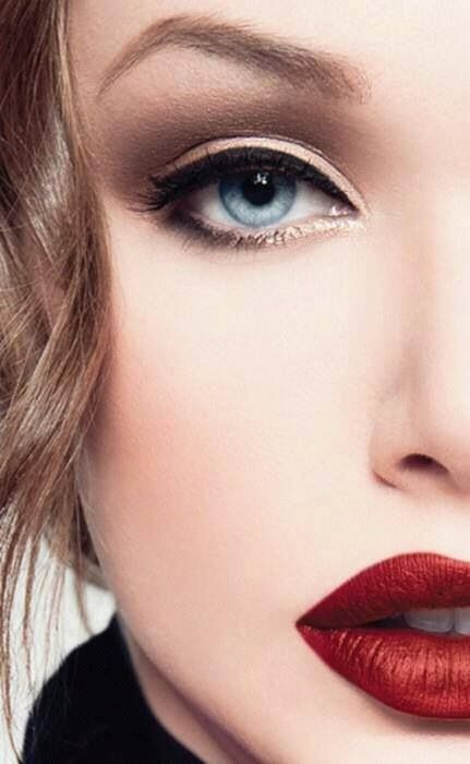 The trick here is the red has been toned down with a hint of gold..which softens it. The corners of the eye also have glints of gold. A good evening/holiday look.