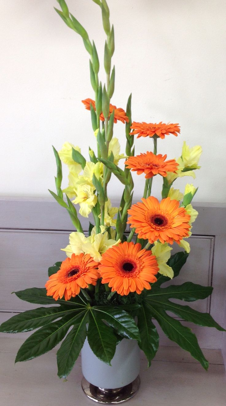 Gladioli and orange gerberas arrangement for our corporate clients.