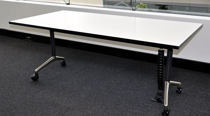Flip Table with Cable Snake Cube in black. The E-Mag-2B is an easy to attach accessory that will fix to steel under the desk, therefore no holes need to be drilled! See more at http://elsafe.com.au/en/case-study-cable-snake