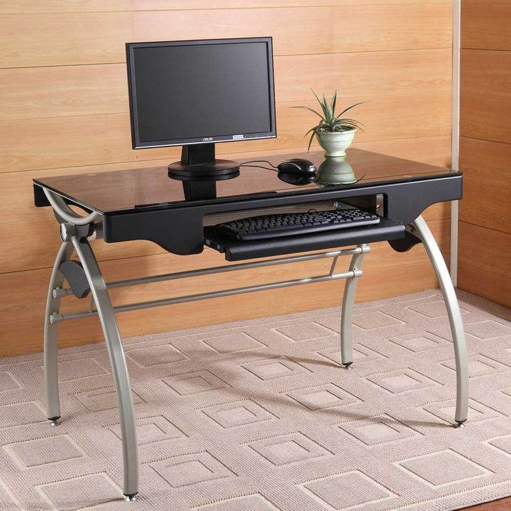 this metal and glass industrial style computer desk features a tempered black glass top arched leg base design keyboard tray and pencil drawer