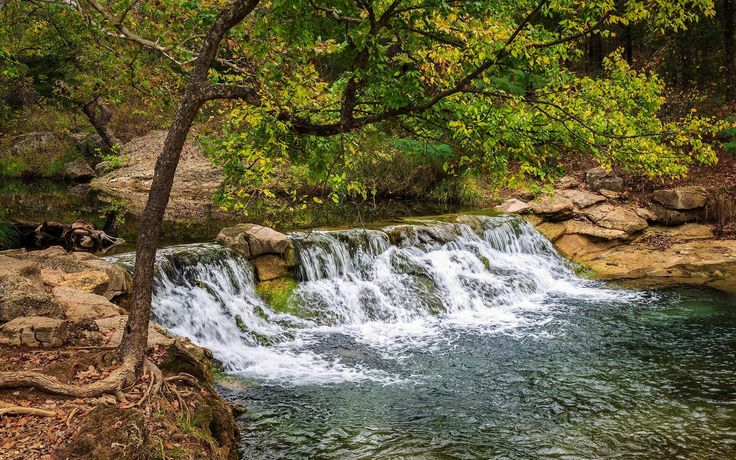 Fisherman, boaters, and swimmers alike will find what they are looking for at Chickasaw National Recreation Area in Oklahoma. Located in the foothills of the Arbuckle Mountains, a quarter of Chickasaw's almost 10,000 acres are covered by water.
