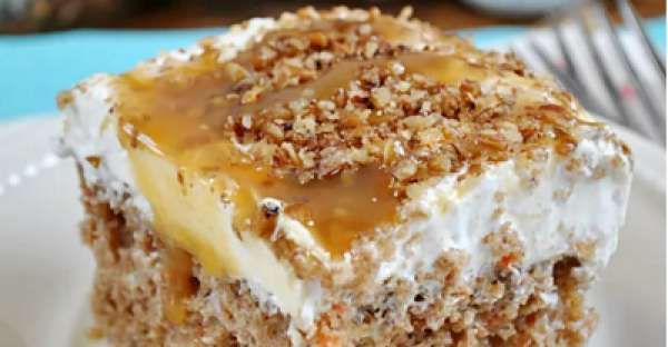 This Better Than Easter Carrot Cake Poke Cake Recipe is an easy Easter recipes desserts the whole fa ...
