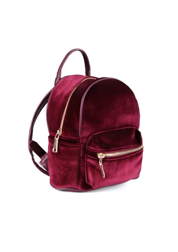 06535807623a An adorable tiny backpack featuring a velvet exterior and leather straps.  Straps are adjustable f.