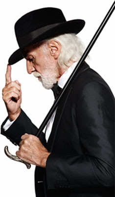 Now this is a dapper Gentleman: soft-spoken and yet formidable, stylish and yet not roaring loudly. The beautiful white hair, the lovely cut of the jacket, the very powerful hat, the cane slung over the shoulder. I love and respect the look of this gentleman.