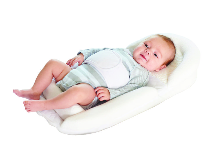 Sleeping Nest The 7 degree angle provides a comfortable position which stimulates digestion and easy breathing. The upper portion of the Nest is made of viscoelastic memory foam, and its shape means babys head is not at risk of flattening due to the supine position. The support belt keeps baby secure, in addition to providing a comforting cover. The removeable bottom roller means that babys legs can be moved into the foetal position, which helps reduce colic.
