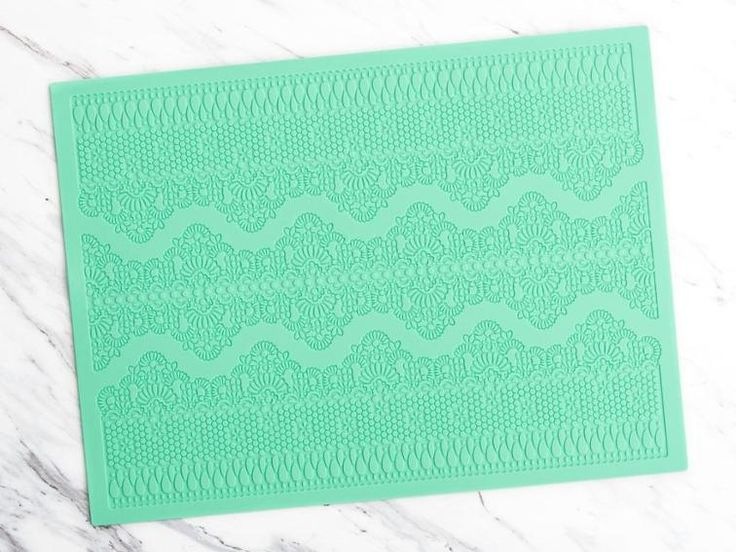 """Add this mesmerizing mold to your stash! The Magic Decor Chennai Cake Lace Mold boasts an alluring pattern and measuring 16""""x12"""". It's compatible with any edible lace mix and is oven-safe up to 250 degrees Fahrenheit."""