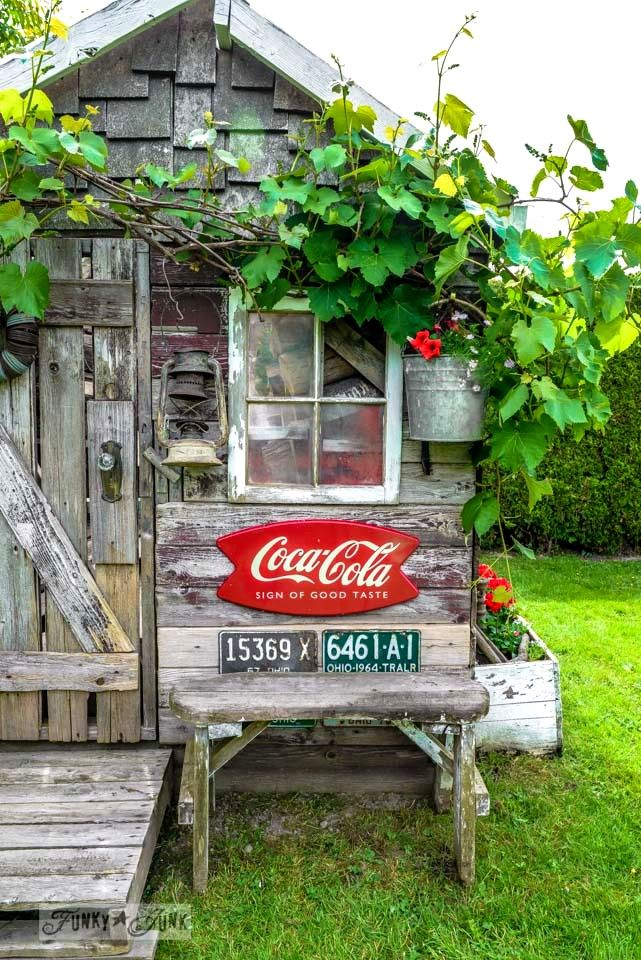 Coke sign and vintage license plates. Why not adorn your cubby house with cool finds.