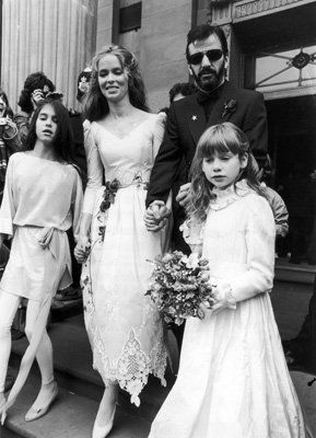 Left to right, Lee Starkey (daughter of Ringo Starr), American actress BARBARA BACH, English musician RINGO STARR, and Francesca Gregorini (Bach's daughter) walk together hand in hand on Starr and Bach's wedding day, London, England in 1981. This was the second wedding for both Starr and Bach.