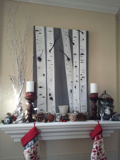 Create a winter feeling for Christmas by painting some birch trees on canvas texturing it with plaster before you paint.