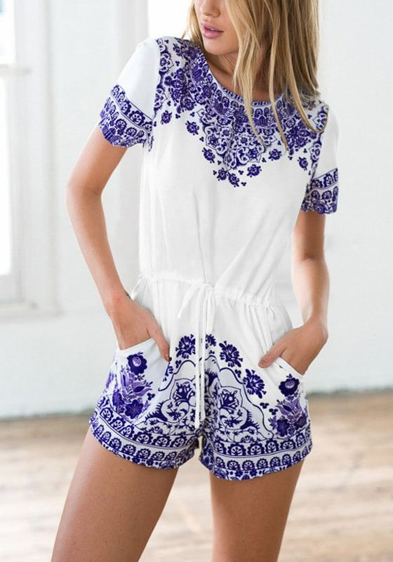Girl posing while wearing a porcelain print drawstring romper