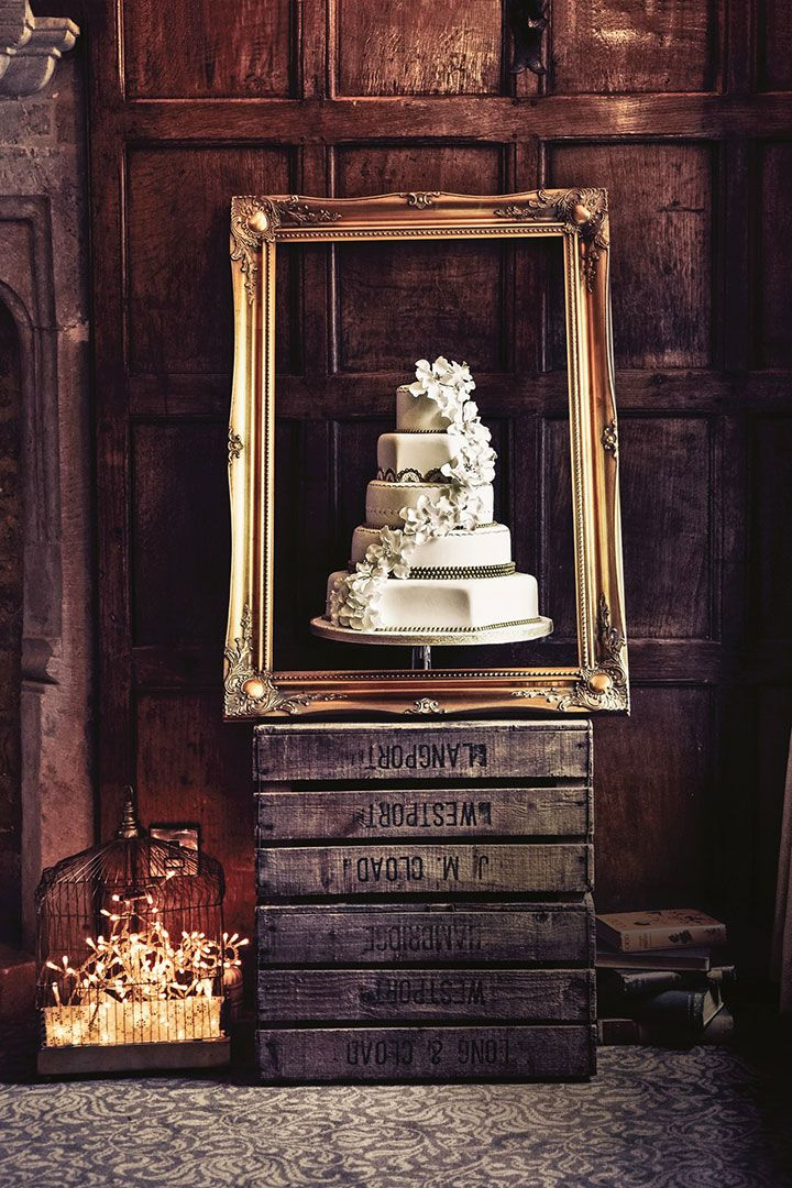 Why not frame your wedding cake?  Easy DIY:  one pallet, one gold frame, a few hardback books and a bird cage with fairy lights...