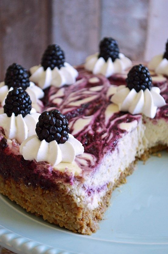 A velvety smooth gluten free Blackberry Swirl Granola Cheesecake with a buttery granola crumb crust. Serve with fresh blackberry puree and whipped cream for a rich and decadent dessert. Holy yummin...