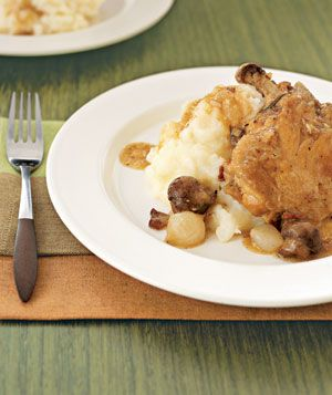 Slow-Cooker Chicken With Bacon, Mushrooms, and Onions: The chicken cooks slowly in the oven until falling-apart tender in this easy version of coq au vin.