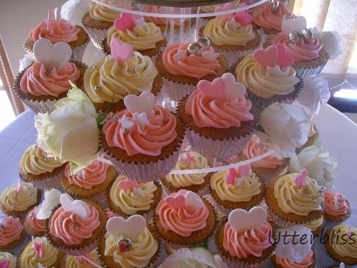 Pink wedding cupcakes.