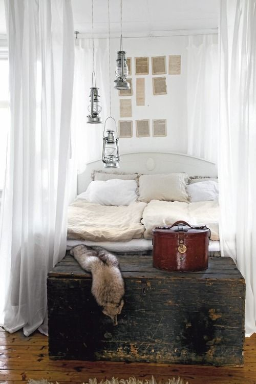 Natural and white country style bedroom. We have trunks, old books @PorchLightIowa