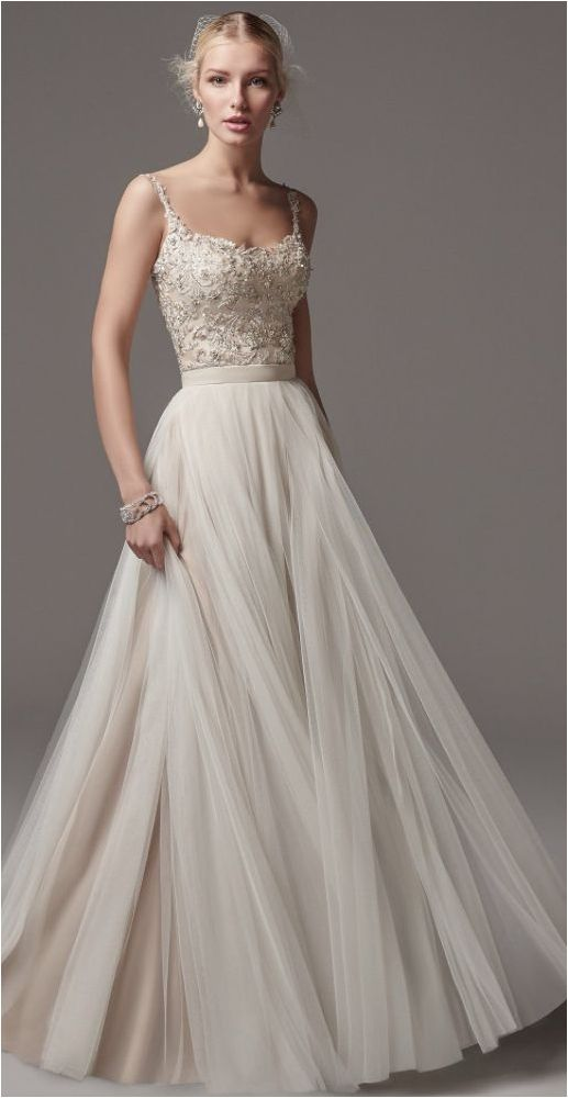 Attractive Elegant Tulle Skirt Wedding Gown Ideas https://bridalore.com/2018/03/14/elegant-tulle-skirt-wedding-gown-ideas/ #weddinggowns
