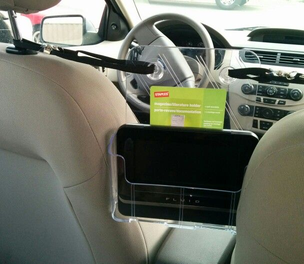 portable dvd player in a clear magazine holder from staples keeping a distance