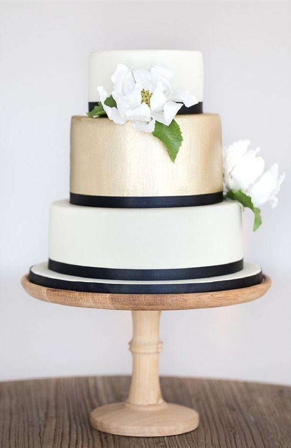 Simple Gold White Black cake with white and green flowers