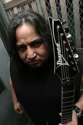 "Dino Cazares aka ""Asesino"" during his time in Brujeria. Guitar. Also in bands: Divine Heresy, Asesino, Fear Factory."