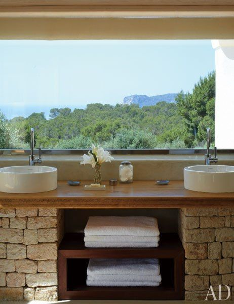 What a bathroom with a view like that! // Jane and Max Gottschalk's Family Retreat on Ibiza : Architectural Digest