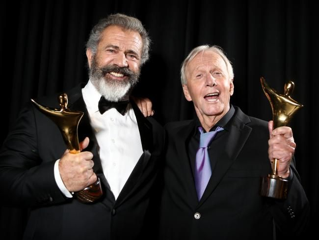 Mel Gibson and Paul Hogan backstage celebrating their AACTA wins 2016. Picture: Chris Pavlich