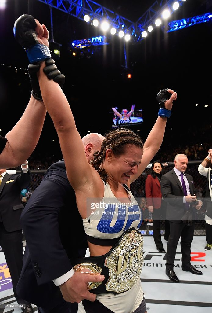 Miesha Tate reacts to her victory over Holly Holm in their UFC women's bantamweight championship bout during the UFC 196 event inside MGM Grand Garden Arena on March 5, 2016 in Las Vegas, Nevada.