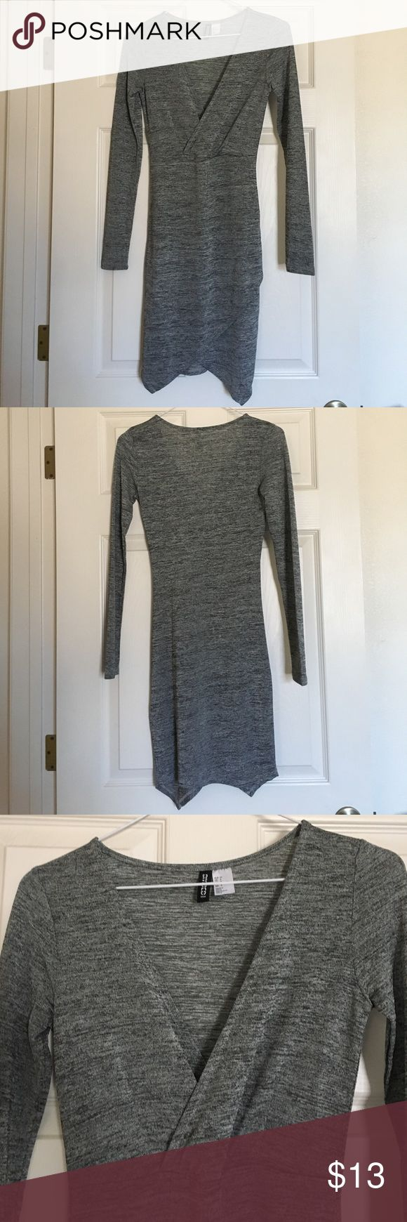 Divided by H&M Longsleeve V-Neck Dress Grey long sleeve v-neck dress with a tulip looking cut at the bottom from H&M. This form fitting dress has fabric a bit to thin for my liking so it has never been worn. H&M Dresses Long Sleeve