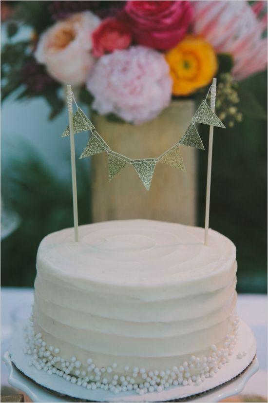 SusieCakes   gold bunting wedding cake   http://susiecakes.com/weddings/