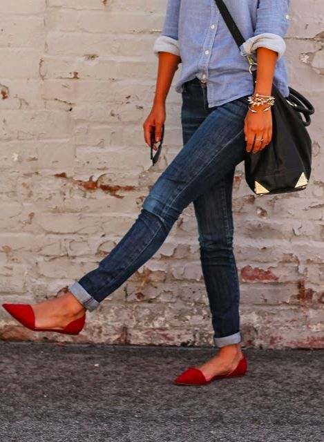 Casual Chic. Light blue dress shirt, dark blue jeans, red flats, black leather purse with gold edge.