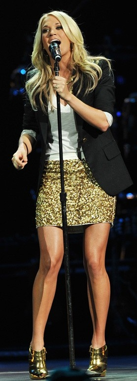 Who made  Carrie Underwood's gold boots and gold sequin skirt that she wore to Nashville Rising: A Benefit Concert for Flood Relief on June 22, 2010?